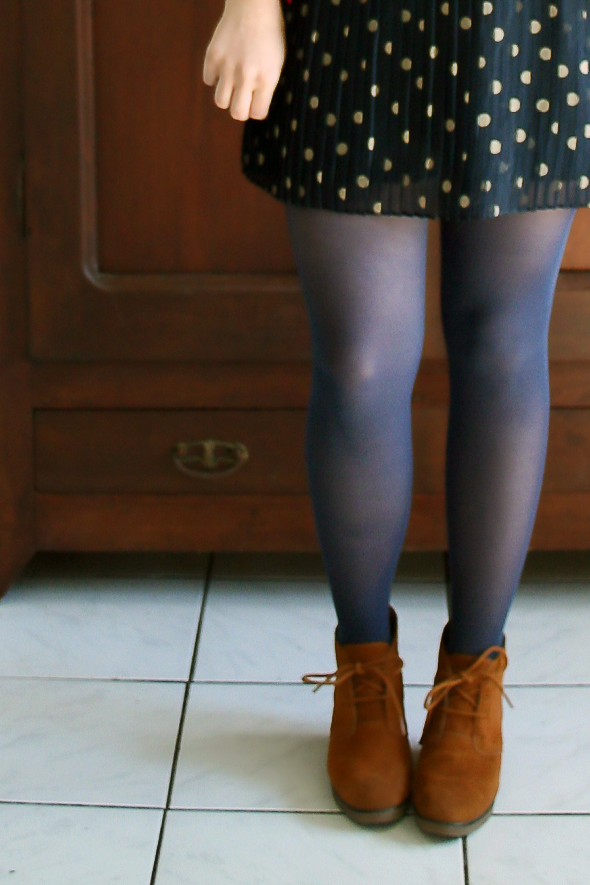 navy polka dot dress and ankle boots