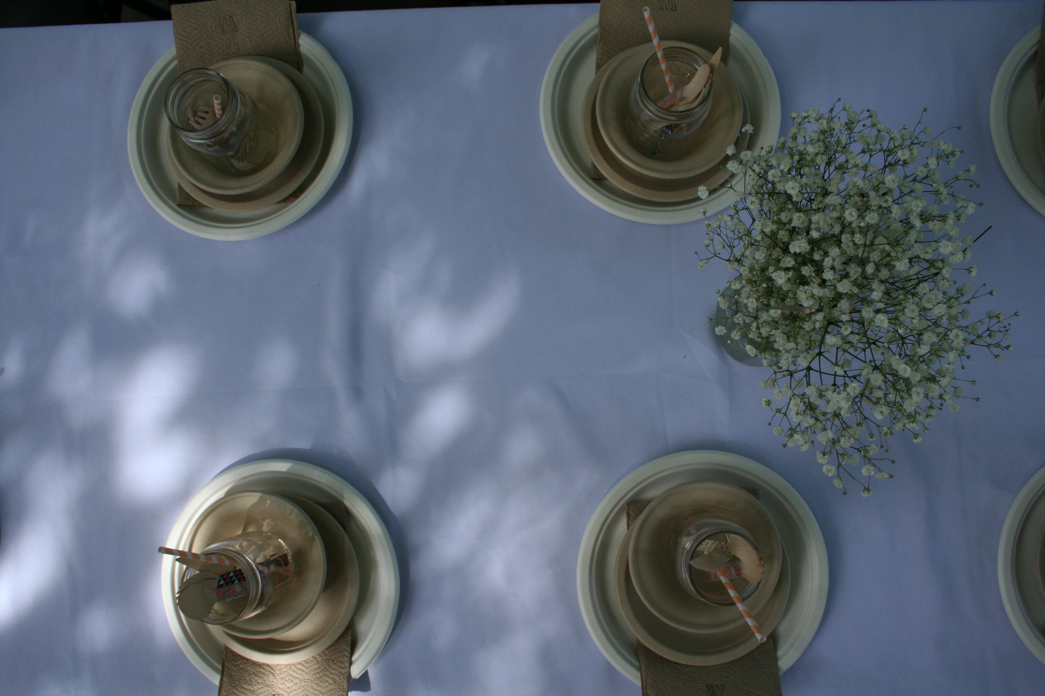 White linen table cloth, recycled paper plates and mason jars | thelovelylauralife.com