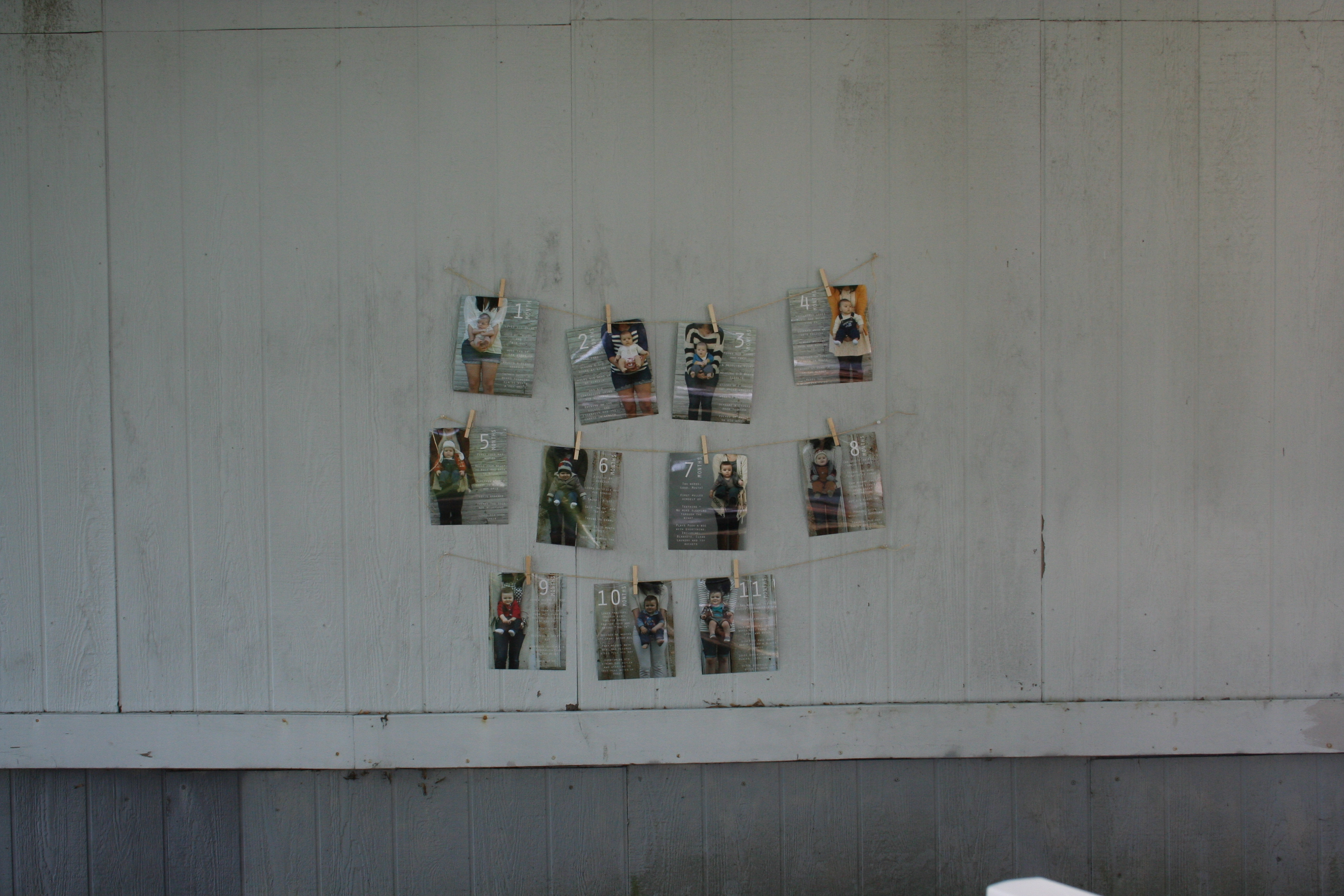 Use monthly photos as a decorations displaying them with clothes pins and twine |thelovelylauralife.com
